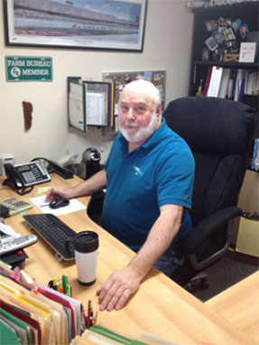 Imagae of Al Gillette at his desk